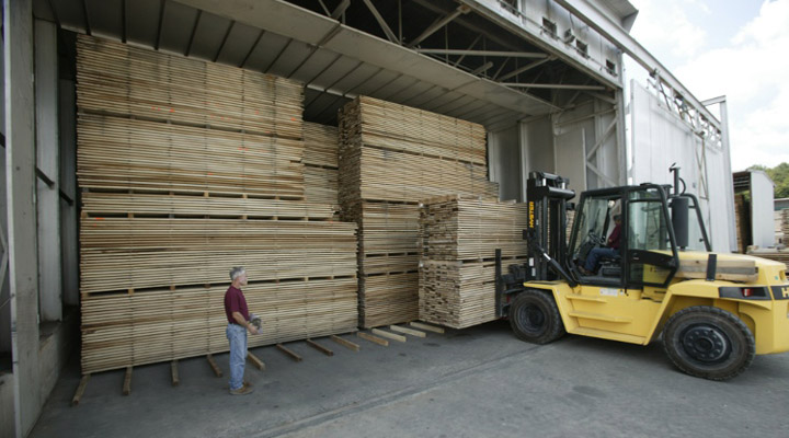 Loading lumber into a drying kiln at J Gibson McIlvain
