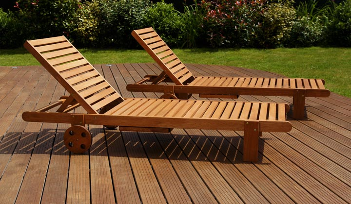 two lawn chairs on backyard wood decking